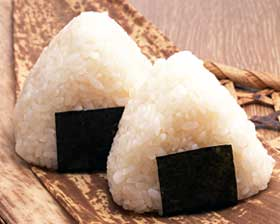 Riceballs, in Japanese: onigiri.  Most definitely NOT donuts.