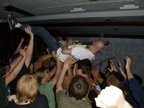 How many artists rock out in their own mosh pit while performing?